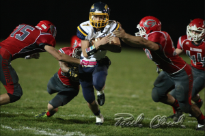 Leyton Stutsman runs for daylight through a group of Glenwood tacklers during Friday night's win.