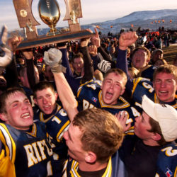 PHOTO SPECIAL TO THE DENVER POSTRIFLE - RIfle High players celebrate their 7-6 victory over Sterling in the 3A State High School championship game, 4 Dec.PHOTO SPECIAL TO THE DENVER POST by Ed Kosmicki 2004
